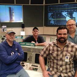 Tim Weeks (left) with Nate Shuppert (right) and tv crew at Apollo Mission Control Room.